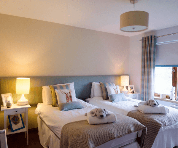 Two twin beds with light bedding