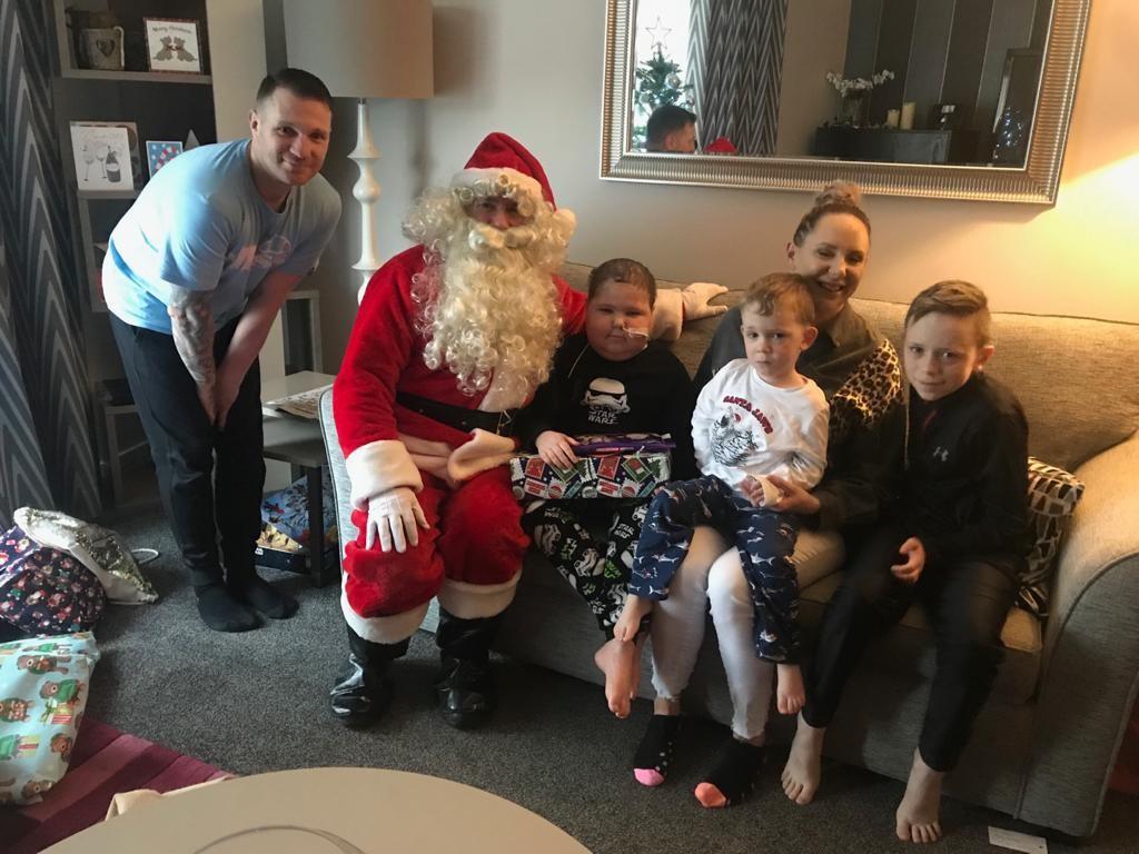 Joel and family with Santa